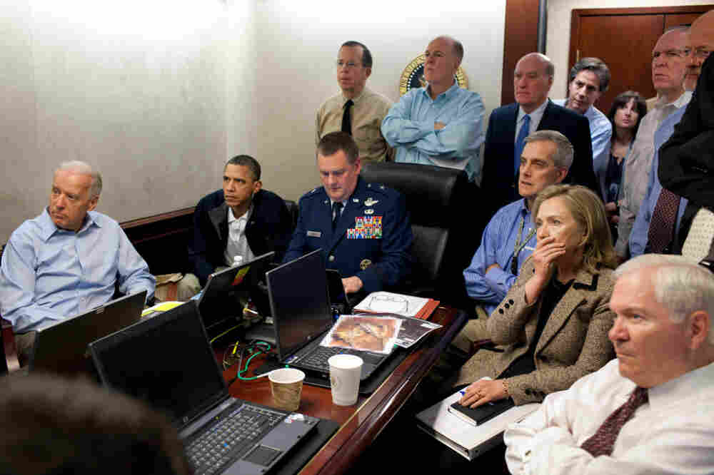 President Obama, Vice President Biden and members of the president's national security team receive an update on the mission against Osama bin Laden in the Situation Room of the White House. A classified document seen in this photograph has been obscured.