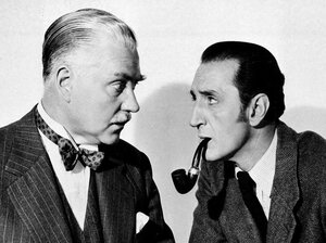 Basil Rathbone (right), as Sherlock Holmes, and Nigel Bruce, as Dr. Watson, in The Adventures of Sherlock Holmes, 1945.
