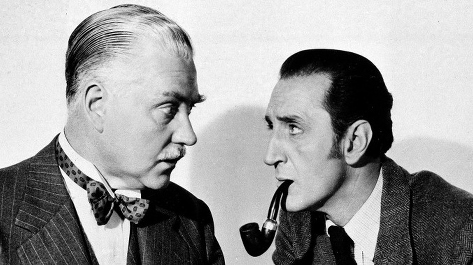 Basil Rathbone (right), as Sherlock Holmes, and Nigel Bruce, as Dr. Watson, in <em>The Adventures of Sherlock Holmes</em>, 1945.