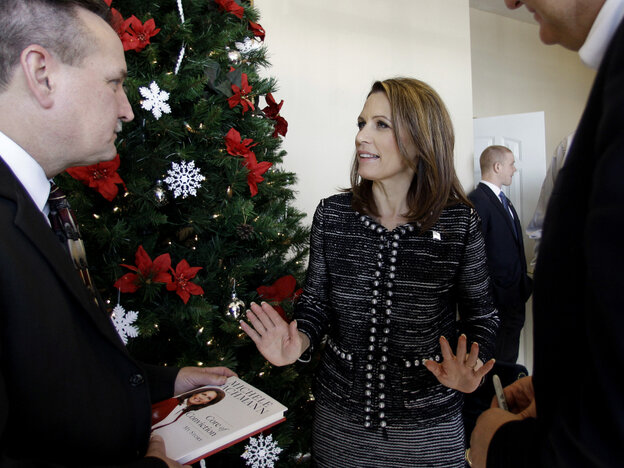 Republican presidential candidate Rep. Michele Bachmann visits with Pastor M