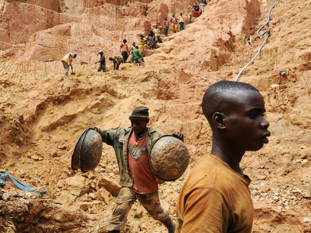 Workers dig at a mine in Chudja, near Bunia, north eastern Congo. The conflict in the Congo, a nation rich in mineral resources such as gold, diamonds, tin, and cobalt, has often been linked to a struggle for control over its minerals resources.