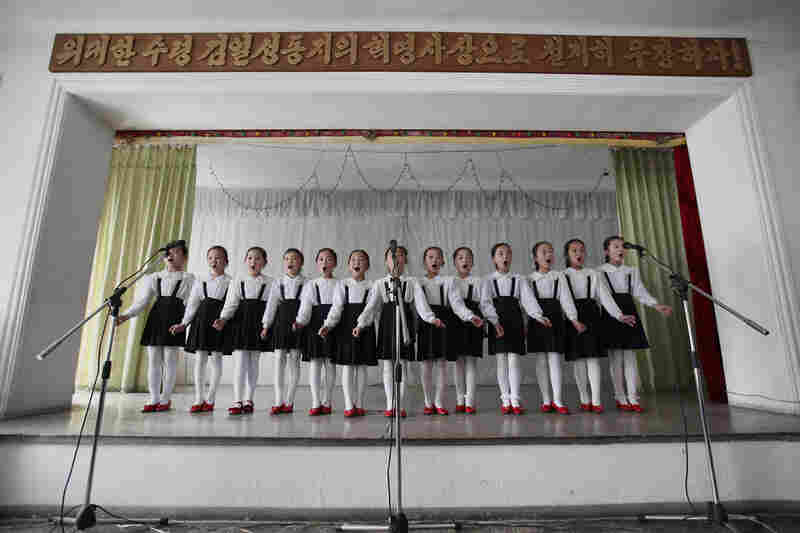 North Korean children perform at a primary school in Pyongyang.