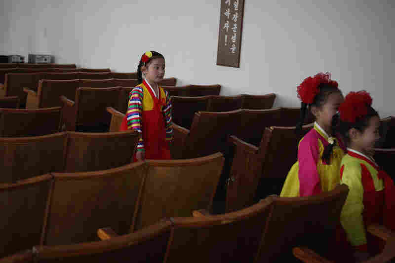 North Korean children leave the classroom after performing in a primary school.