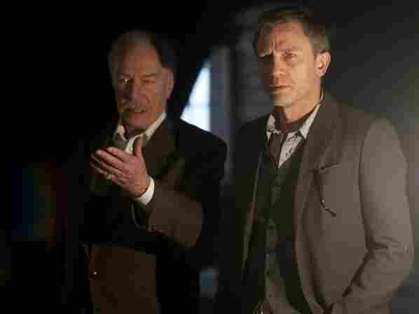 Henrik Vanger (Christopher Plummer, left) offers Mikael Blomkvist (Daniel Craig) a big paycheck to crack the mystery of his missing granddaughter.