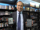 E-books surged in popularity in 2011. Here, Jean-Louis Raynard, chairman of the board of Virgin Megastore France, poses with the Cybook Odyssey tablet (left) a French e-reader from Bookeen, and the Kindle tablet (right), developed by Amazon.