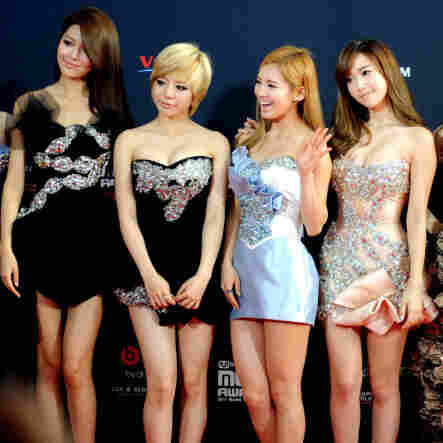 Korean pop group Girls' Generation pose on the red carpet to attend the MNET Asian Music Awards ceremony in Singapore in November.