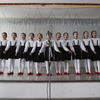 North Korean children perform in a primary school in Pyongyang.