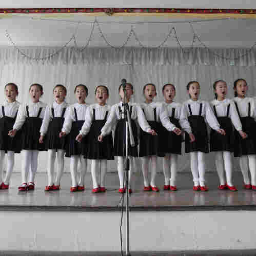North Korean children perform in a primary school in Pyongyang.