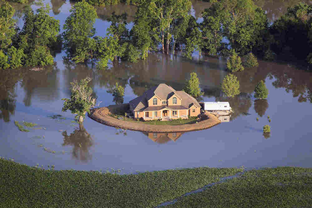 A levee protects a home surrounded by floodwaters from the Yazoo River near Vicksburg, Miss., May 18.