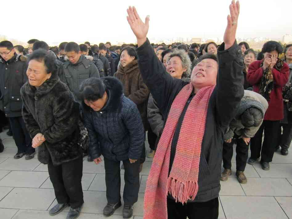 North Koreans mourn the late dictator, Kim Jong Il after Kim Jong Il's death was announced Monday, Dec. 19, 2011.