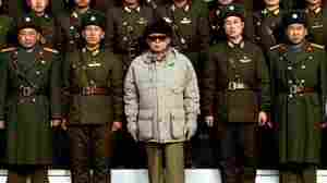 Korean Central News Agency photo released on Jan. 18, 2009, showing North Korean leader Kim Jong Il posing with soldiers.