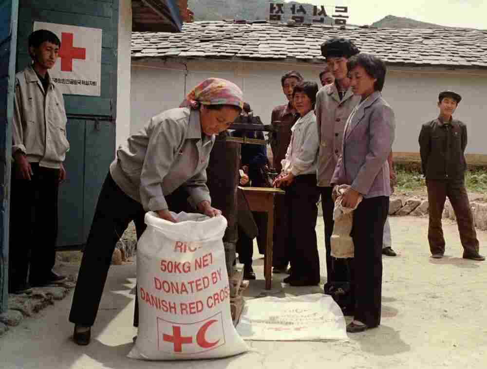 "North Korean residents line up to receive food rations at a Red Cross distribution center in Tongsin, North Korea, in 1997. Discussions over U.S. food aid to the reclusive country were to take place Monday. ""You could, in a very real sense, see the needs for food assistance,"" said an official with Mercy Corps, after a September 2011 visit to the country."