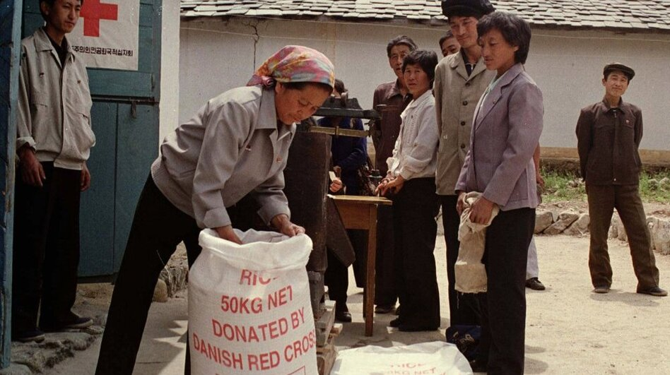 """North Korean residents line up to receive food rations at a Red Cross distribution center in Tongsin, North Korea, in 1997. Discussions over U.S. food aid to the reclusive country were to take place Monday. """"You could, in a very real sense, see the needs for food assistance,"""" said an official with Mercy Corps, after a September 2011 visit to the country."""