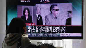 In Seoul today: South Koreans watch a television broadcast about the death of North Korean leader Kim Jong Il.