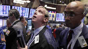 Traders Richard Cohen (left) and Lewis Vande-Pallen work on the floor of the New York Stock Exchange on Nov. 21.