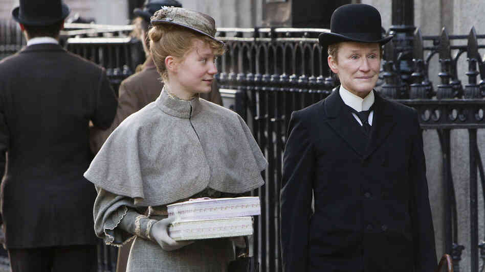 Mia Wasikowska (left) and Glenn Close are an unlikely couple in Albert Nobbs, a forlorn romance about a woman passing as a man to find work in 19th-century Ireland.
