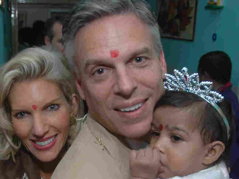 Jon Huntsman and his wife, Mary Kaye, with their adopted daughter, Asha Bharati, at Matruchhaya Orphanage in Nadiad, India, Dec. 19, 2006.