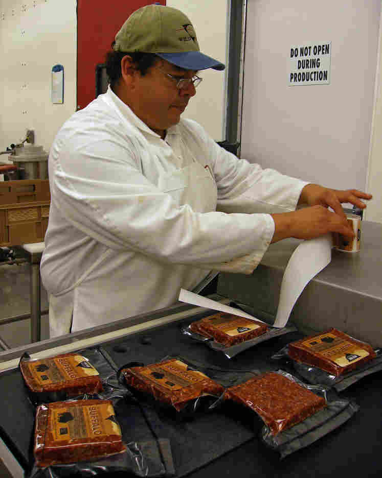 Shane Brown, a butcher with the Wild Idea Buffalo Co., labels packages of ground bison.