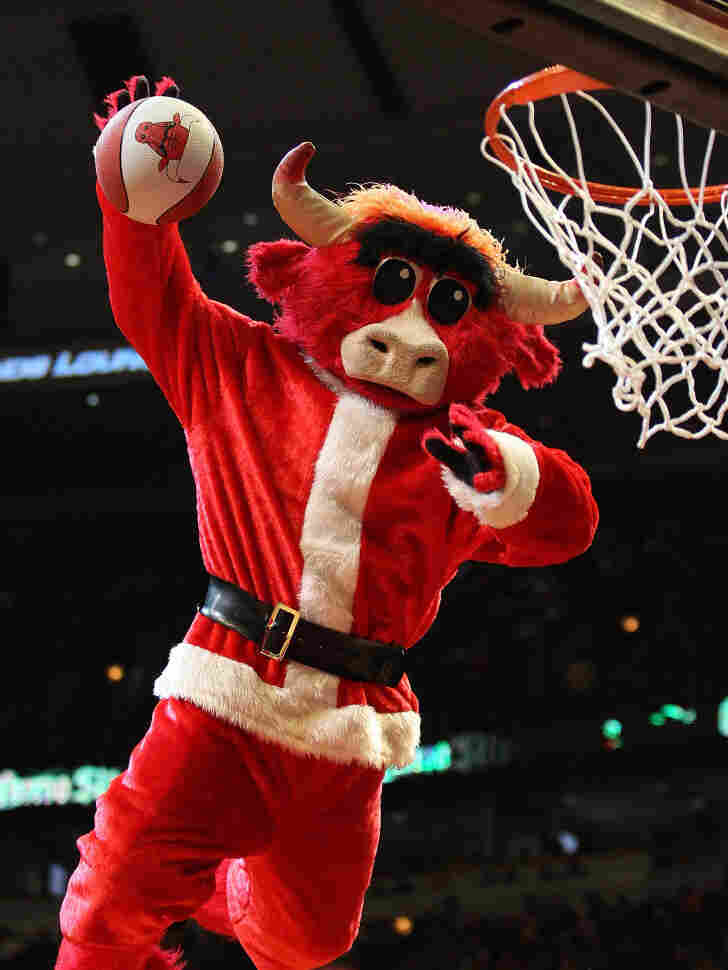 The Chicago Bulls mascot, dressed as Santa Claus, dunks during a game last December. The NBA is starting its season on Christmas Day, with a quintuple-header.