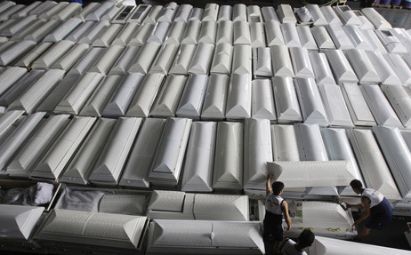 Philippine Navy personnel prepare coffins for shipping to Mindanao Island after tropical storm Washi hit the country last week in one of the worst disasters to strike the region in decades.