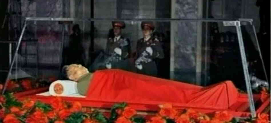 A screen shot from North Korean TV foottage shows Kim Jong Il's body lying in a glass coffin in Pyongyang.