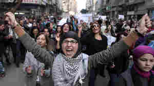 Scores Dead In Syria; Thousands Of Women Protest In Egypt
