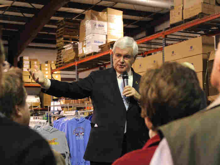 Republican presidential candidate Newt Gingrich makes remarks at a town hall meeting at Level 10 Apparel's screen-printing warehouse, in Hiawatha, Iowa, Dec. 19.