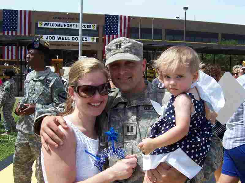 Siobhan Fallon welcomes home her husband from deployment with her daughter, Maeve, in 2009.