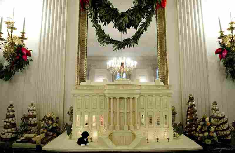 """""""Shine, Give, Share"""" is the theme for the Obama family's third Christmas in the White House. This year, a total of 37 Christmas trees and a 400-pound White House made of gingerbread, white chocolate and marzipan decorate the mansion."""