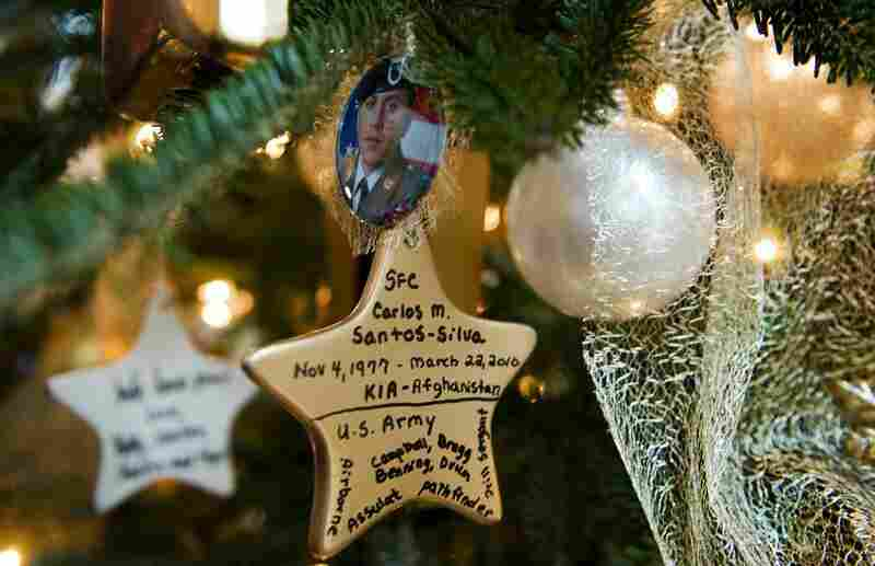 Ornaments made to honor loved ones decorate the Gold Star Families Tree.