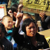 In a rare mass protest, thousands of people from the besieged village of Wukan, China, gather to demonstrate against what they say are illegal land seizures by the government. The villagers accuse local officials of selling 6.5 square miles of their land to boost government revenues.