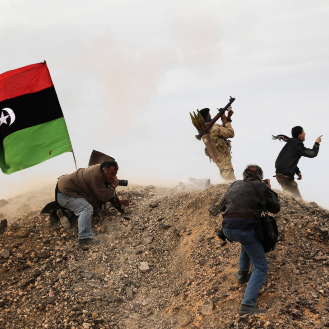 Photojournalists, including New York Times staff photographer Tyler Hicks, photograph Libyan rebels on March 10 in Ras Lanuf, Libya. Hicks and three other Times journalists -- Stephen Farrell, Lynsey Addario and Anthony Shadid -- were released March 21 after being held captive by Libyan forces.