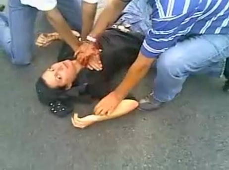 Neda Agha-Soltan lying on the ground after being shot in Tehran in 2009.