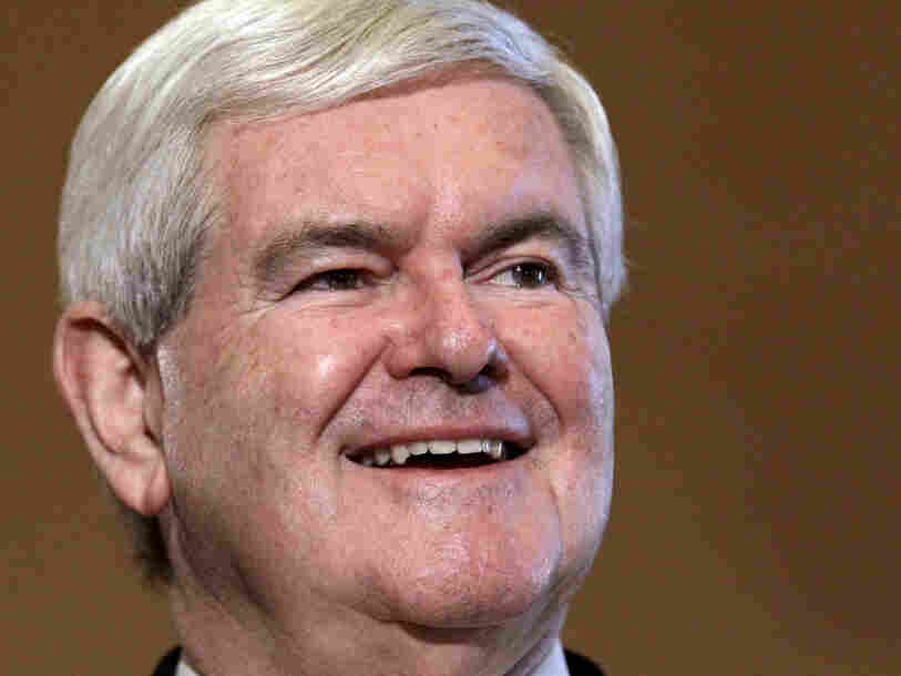 Newt Gingrich is endorsed by Iowa Speaker of the House Kraig Paulsen and New Hampshire Speaker of the House Bill O'Brien in Des Moines, Iowa, on Wednesday.