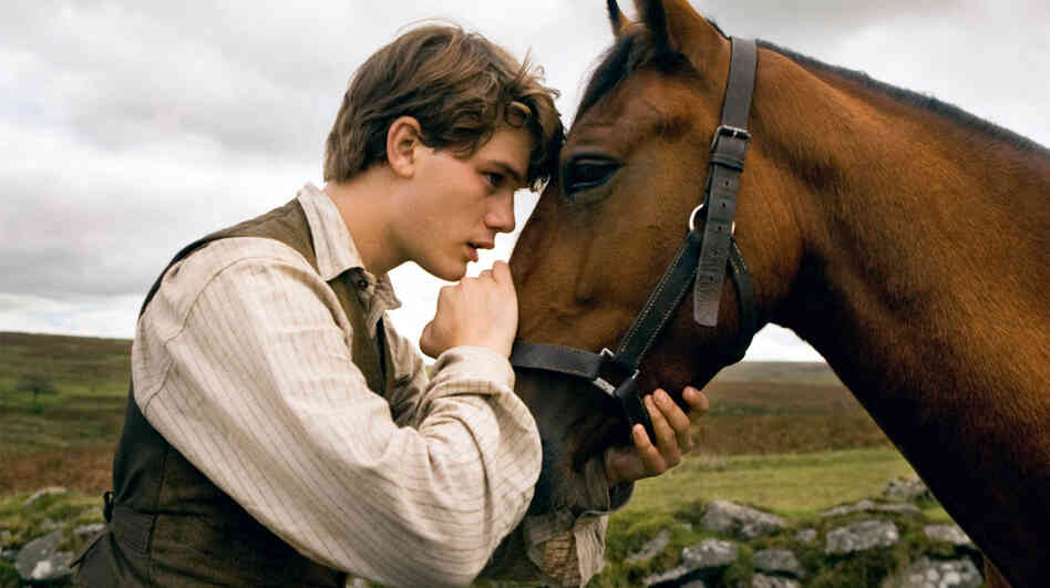 Albert (Jeremy Irvine) enlists in the service during World War I after his beloved horse, Joey, is sold in War Horse.
