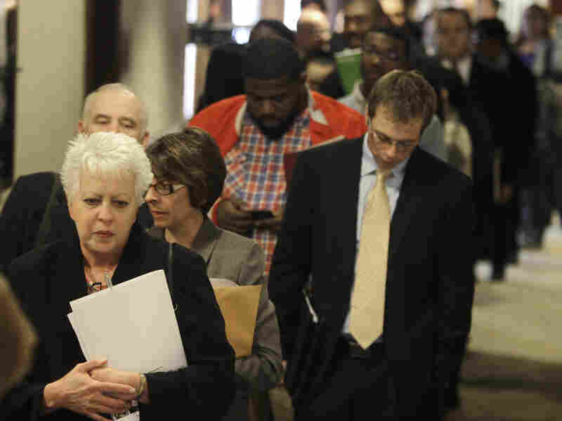 Mary Polocy (left) stands in line to enter a career fair in Independence, Ohio, in November. Congress has yet to agree on a measure that would extend unemployment benefits.