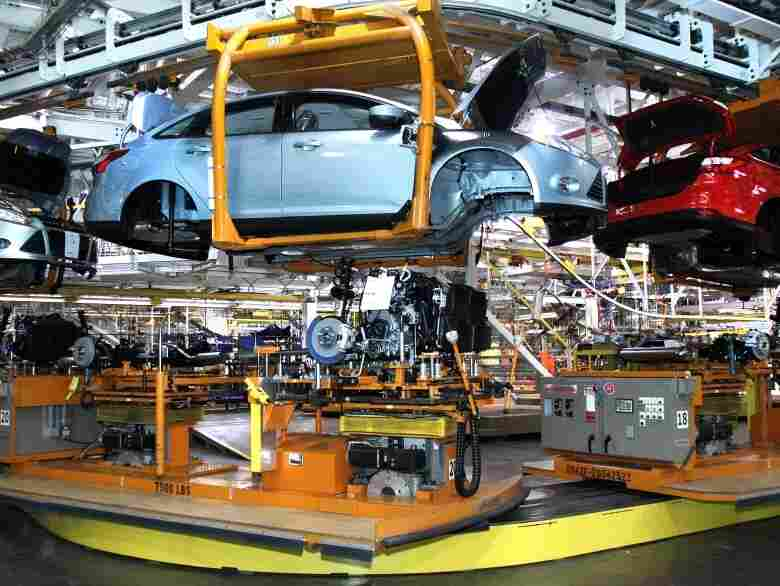 Workers build cars on the assembly line at the Ford Motor Co.'s Michigan Assembly Plant Dec. 14, 2011.
