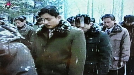This image taken today from North Korean TV footage shows people mourning for Kim Jong Il in Pyongyang.