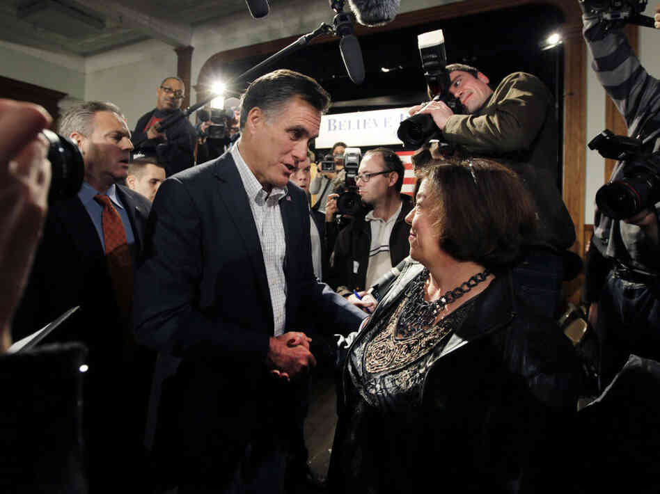 Republican presidential candidate, former Massachusetts Gov. Mitt Romney greets voters after his campaign speech in Bedford, N.H. on Dec. 20.