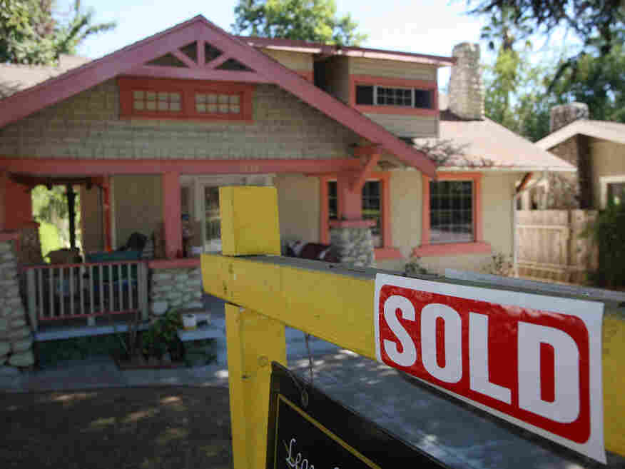 """A """"sold"""" sign outside a home in Pasadena, Calif., in September 2009. New data show fewer such sales that year."""
