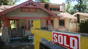 "A ""sold"" sign outside a home in Pasadena, Calif., in September 2009. Ne"