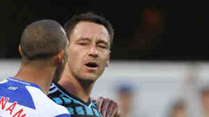 John Terry, right, and opponent Anton Ferdinand during the English Premier League on Oct. 23 in which it's alleged that Terry hurled a racial slur at Ferdinand. Terry denies doing that. He's going to face criminal