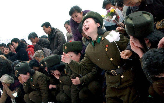 This handout picture taken by North Korea's official Korean Central News Agency on December 21 shows members of the Ko