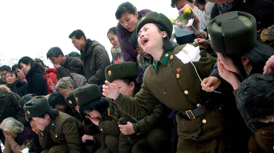 This handout picture taken by North Korea's official Korean Central News Agency on December 21 shows members of the Korean People's Army crying for late North Korean leader Kim Jong-Il in Pyongyang. (AFP/Getty Images)