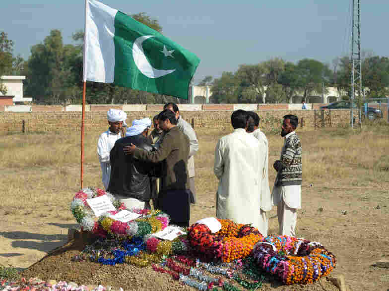 Relatives of Pakistani soldier Havildar Mumtaz Hussain gather in front of his grave this month in the village of Bhagwal, about 70 miles southeast of Islamabad. Hussain was one of 24 Pakistani soldiers killed in a NATO shooting on Nov. 26.