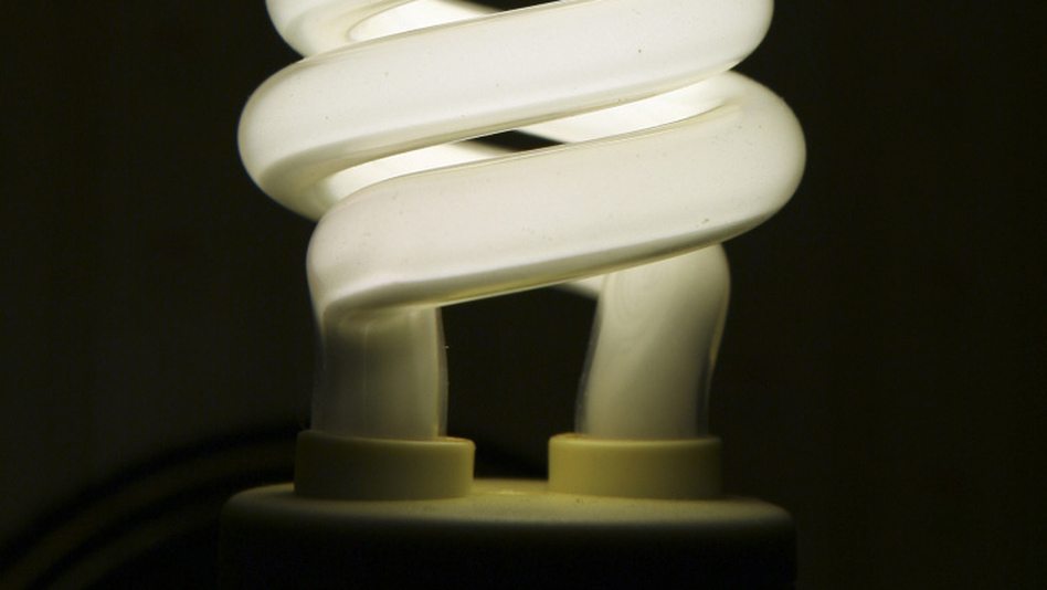 "The <a href=""http://www.lightbulboptions.org/files/TabbedPDF.pdf"">National Electrical Manufacturers Association</a> says compact fluorescent bulbs like this are significantly more efficient than incandescent bulbs."
