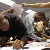 Applicants fill out forms at a Miami jobs fair hosted by the Congressional Black Caucus.  An NPR/Kaiser survey found blacks make up about 10 percent of the full-time working population but 27 percent of the long-term unemployed.
