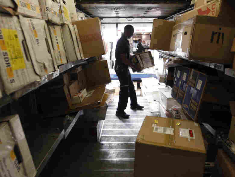 Bill Ferguson, a courier for FedEx, loads his truck at a sorting facility in Chicago on Dec. 12 — the company's busiest day in its history.