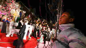 Onlookers gather in front of the Garabedian family home in the Bronx in this 2004 photo. The Garabedians have decorated their home for nearly four decades with lights and hundreds of animated figurines.
