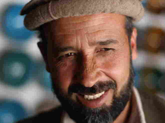 Abdul Wahkeel at his pottery stall in the Afghan village of Istalif. He was among the first potters to return after the fall of the Taliban.